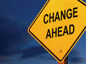"Image of a street sign with the words ""Change Ahead."""